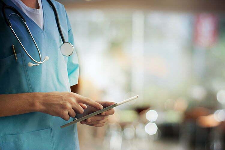 Nurse holding tablet asbestos disease mesothelioma health professional